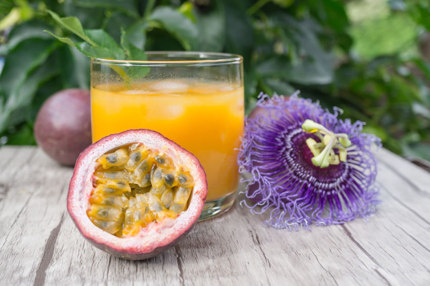 Passion Fruit Flower Blood Orange Citrus Fruit Close-up Cross Section Day Drink Drinking Drinking Glass Food Food And Drink Freshness Fruit Halved Healthy Eating Indoors  Maracujá No People Passion Fruit Passion Fruits Ready-to-eat Refreshment SLICE Table Wood - Material Mix Yourself A Good Time