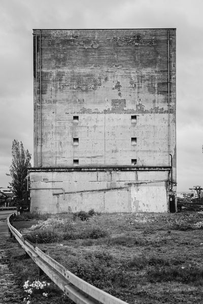 Abandoned Silo Abandoned Architecture Blackandwhite Built Structure Commerce Deterioration Economy Factory Hatches Indusrty No People Obsolete Old Outdoors Silo Stone Wall Wall