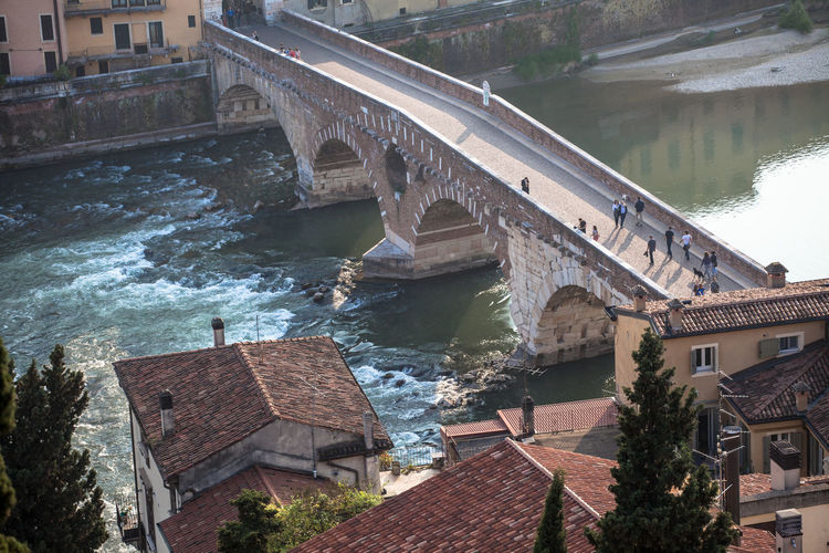 High angle view of people on ponte pietra over adige river