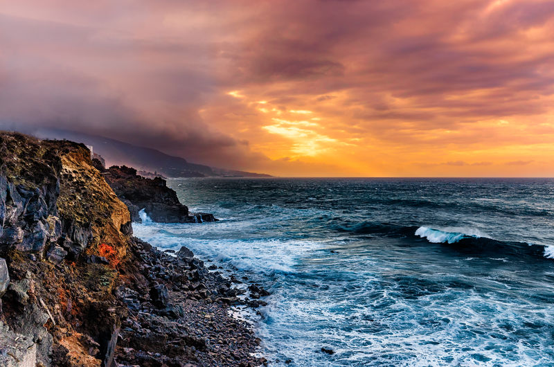 Sunset on the Atlantic coast. The steep and rugged Atlantic coast in the north of Tenerife. The landscape is rocky and some places can only be seen and entered at low tide. Here, in such a place, this photo was taken. A sunset in good weather is a fantastic colorful spectacle. Cliffs Cloud Ocean View Passatwolken Red Sunlight Beach Beauty In Nature Cloud - Sky Day Dramatic Sky Horizon Over Water Nature No People Outdoors Power In Nature Scenics Sea Sky Sunset Teneriffa Water Wave