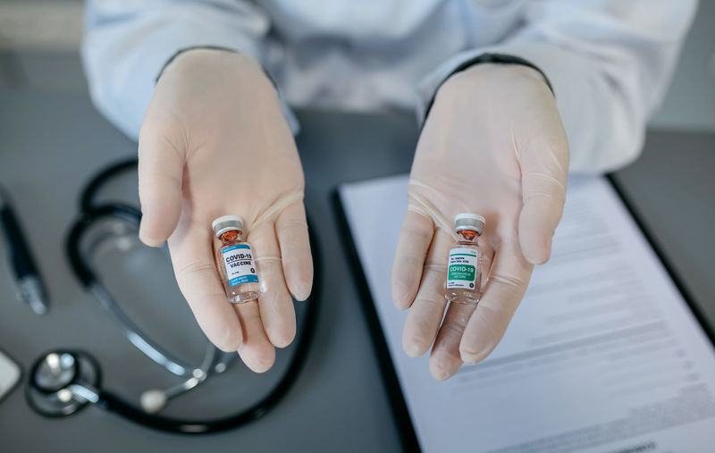 Cropped hands of doctor holding medicines