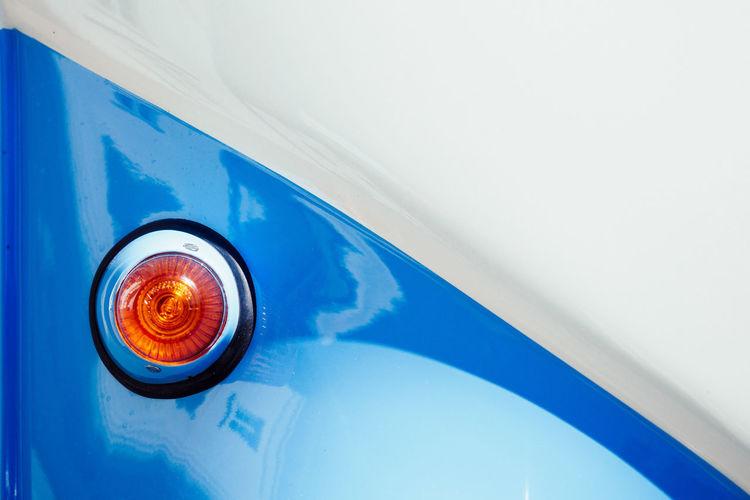 Close-Up Of Light On Blue Car