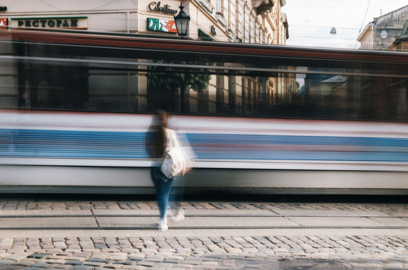 The girl is ahead of the tram to the main square of Lviv. Long exposure Blurred Motion Long Exposure Lviv Motion One Person Passenger Train Public Transportation Rail Transportation Railroad Track Real People Speed Streetphotography Train - Vehicle Tram Transportation Travel Travel Destinations Ukraine The Street Photographer - 2017 EyeEm Awards Mobility In Mega Cities Be Brave