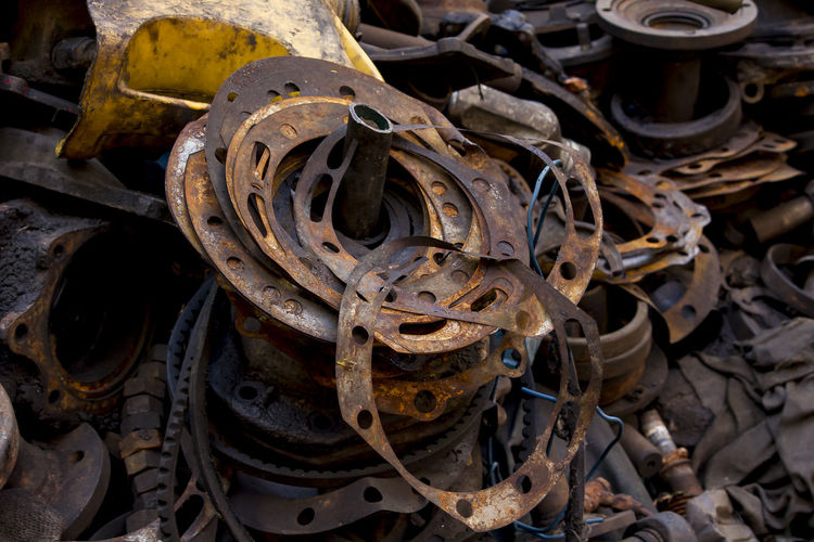 Old gaskets on lots of piles of material. Old Gaskets Backgrounds Close-up Complexity Damaged Day Decline Deterioration Equipment Gaskets Changed Indoors  Industry Iron - Metal Junkyard Machine Part Machinery Metal Metal Industry No People Obsolete Old Run-down Rusty Stack Wheel