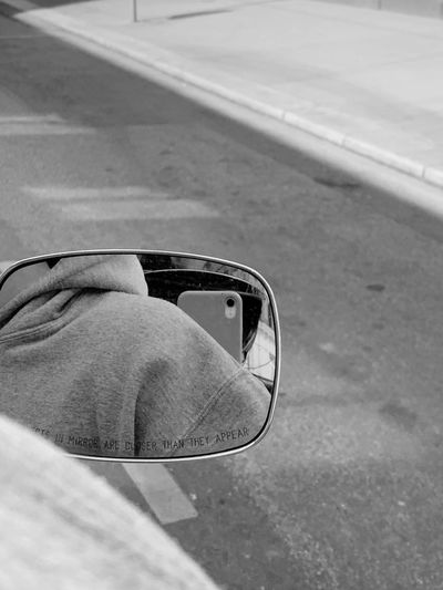 Reflection of person on glass of car