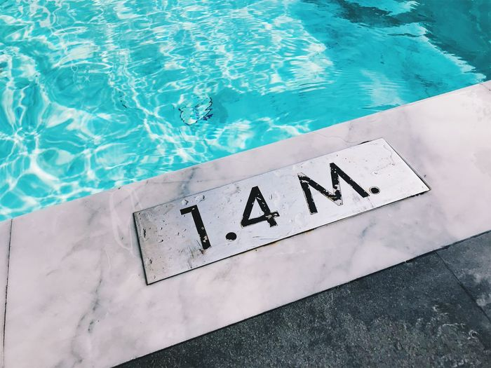 High angle view of text on swimming pool