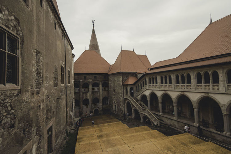 Arch Architecture Building Exterior Built Structure Cloud - Sky Courtyard  Day Entrance Exterior Façade History Hunedoara In Front Of Local Landmark No People Old Town Outdoors Palace Sky Spire  Town Transylvania