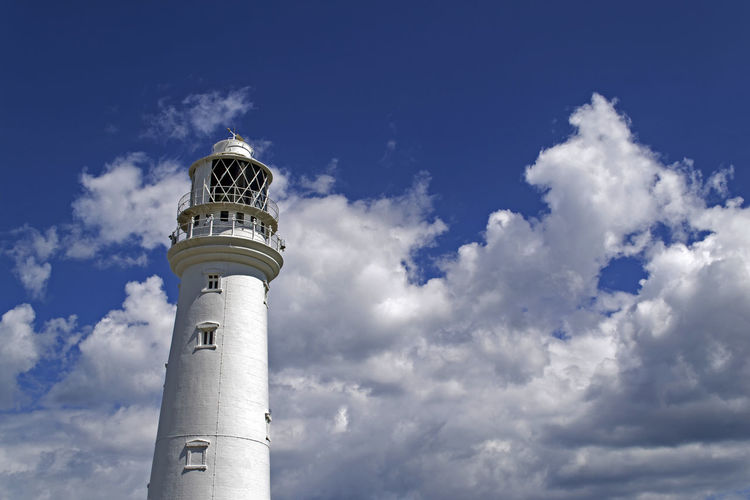 Flamborough Head Lighthouse Flamborough Lighthouse Serenity Yorkshire Architecture Blue Sky Building Exterior Built Structure Cloud - Sky Day Direction Flamborough Head Fluffy Clouds Guidance Lighthouse Low Angle View Nature No People Outdoors Sky