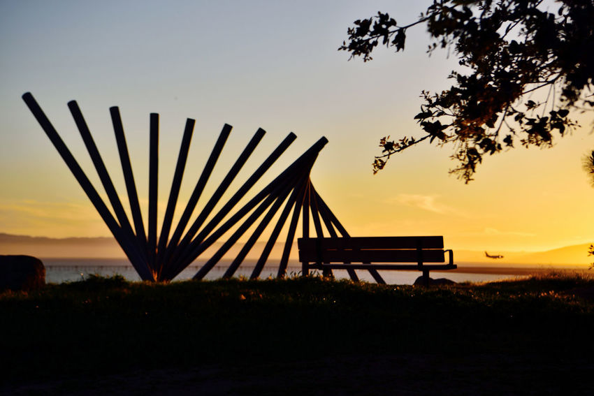 Sunset @ Oyster Bay Pt 6 San Leandro, Ca. Stainless Steel Sculpture Rising Wave 16 Poles Artist: Roger Berry Sunset All About Angles Sunset Silhouettes Sunset_collection Hilltop Bench Sunset Photography Sunset Photography Landscape_Collection Landscape_photography Nature Beauty In Nature Nature_collection San Francisco Bay Landscape Tranquility