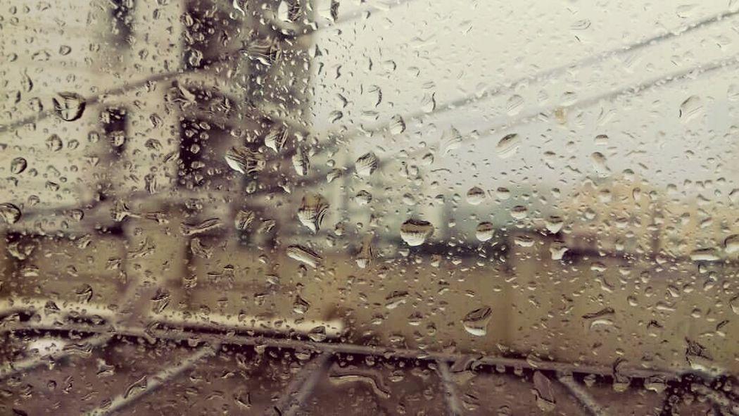 Glass - Material Window Wet Rain Water Transparent Drop Weather Rainy Season Day Looking Through Window Vehicle Interior Transportation Mode Of Transport Full Frame No People Close-up RainDrop Car Sky