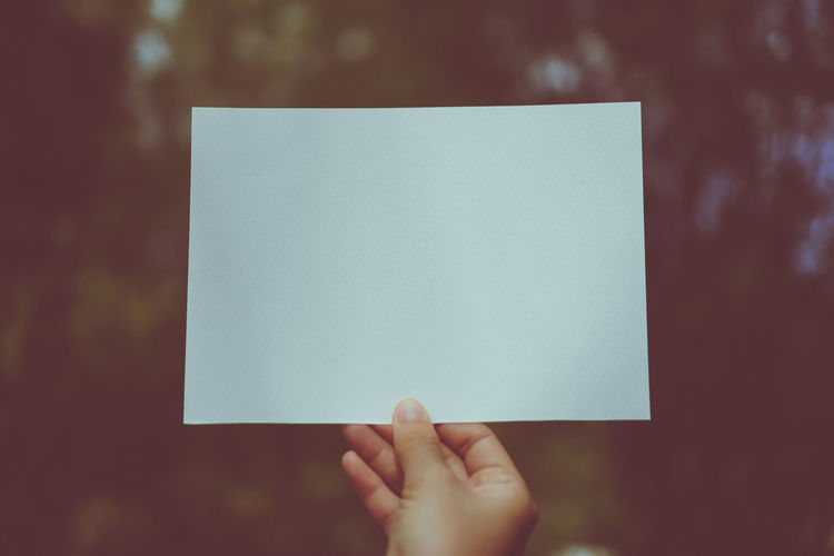 Blank Body Part Close-up Communication Copy Space Finger Focus On Foreground Hand Holding Human Body Part Human Finger Human Hand Message One Person Paper Personal Perspective Real People Showing Unrecognizable Person White Color