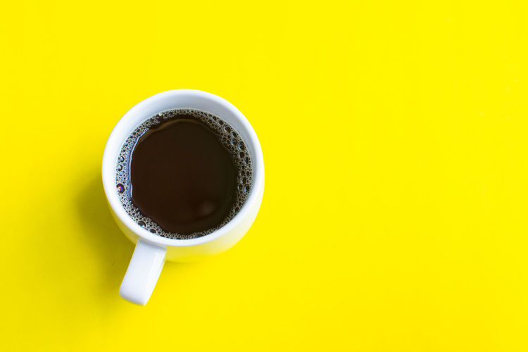 Drink Food And Drink Cup Yellow Coffee Coffee Cup Mug Studio Shot Coffee - Drink Directly Above Indoors  Refreshment Colored Background Still Life Copy Space No People Freshness Close-up High Angle View Yellow Background Crockery Non-alcoholic Beverage