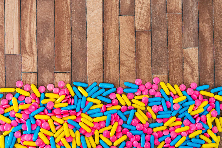 Multi Colored Large Group Of Objects Still Life Abundance No People Sweet Food Variation Wood - Material Directly Above Close-up Choice Pattern Sweet Indoors  High Angle View Full Frame Indulgence Candy Food And Drink Unhealthy Eating Temptation