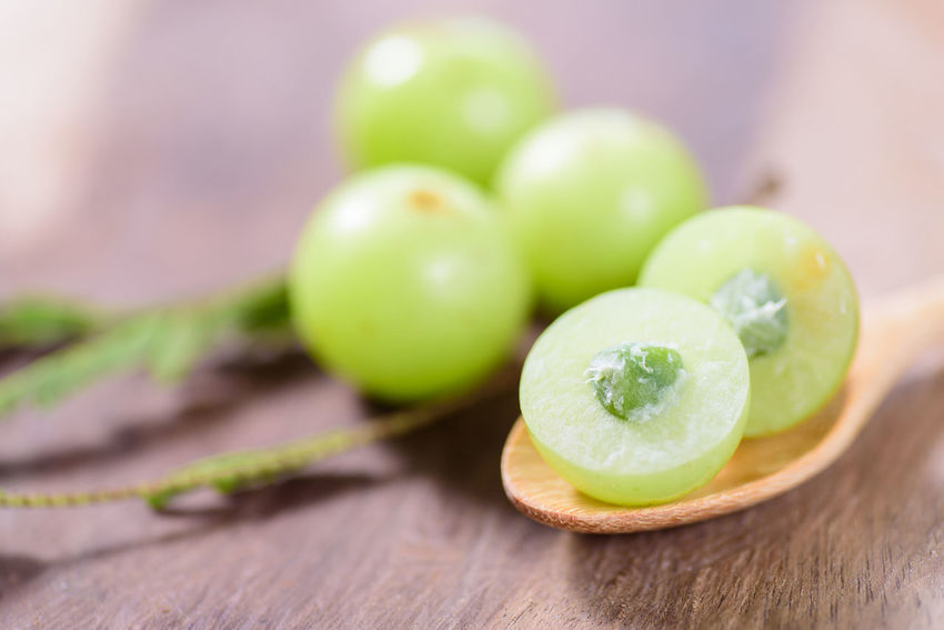 Indian gooseberry fruit Asian  Diet Healty Food Close-up Day Focus On Foreground Food Food And Drink Fresh Freshness Fruit Gooseberry Green Color Healthy Eating Healthy Fruit Indian Gooseberry Indoors  No People Nutrition Ripe Fruit Sweet Table Tropical Vitamin C Wood - Material