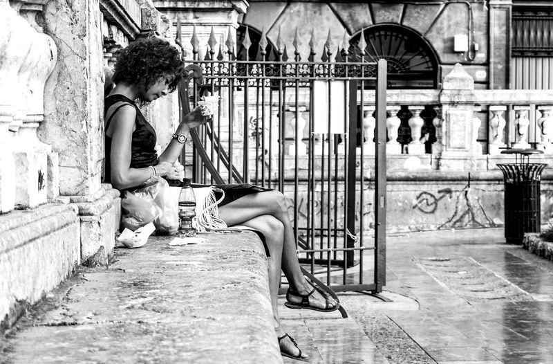street scene Palermo, Sicily, Italy Sitting Full Length Real People Side View Outdoors Contemplation Black And White Streetphotography Street Photography Palermo Sicily Travel Reading Beauty