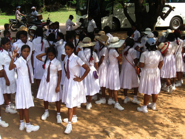 Day Fun In A Row Large Group Of People Motorcycles Outdoors Polonnaruwa School Uniforms Around The World Schoolgirls Side By Side Sri Lanka Sunlight And Shadow White Clothes