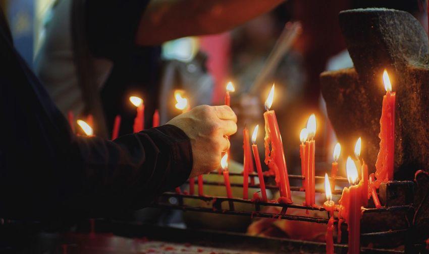 Lighting candle Flame Candle Glowing Religion Human Hand Spirituality Illuminated Place Of Worship Indoors  Phuket Activity Respect Shrine Faith Faithful Many Candles Pray Phuket Festival Lighting Lighting Candle God Festival