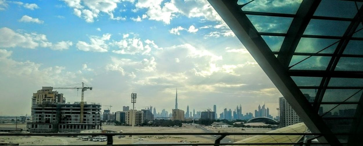 Dubai Dubai Skyline Construction Work Cloudy Skies Burj Khalifa UAE Emirates Skyline Dubai Station Entering Station Clouds And SkyMetropolis Sand And Skyscrapers The Architect - 2016 EyeEm Awards Clouds Clouds And Sky Envision The Future The Great Outdoors With Adobe On The Way