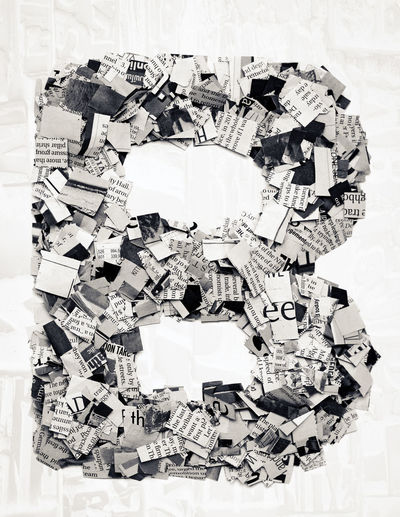 capital letter made from cut ot newspaper BIG Macro Photography Multiple Layers Newsprint Printed Text The Media Typography Above Capital Letter Confetti Design Detail Monochrome Montage News Newspaper Paper Printed Media Toned Image