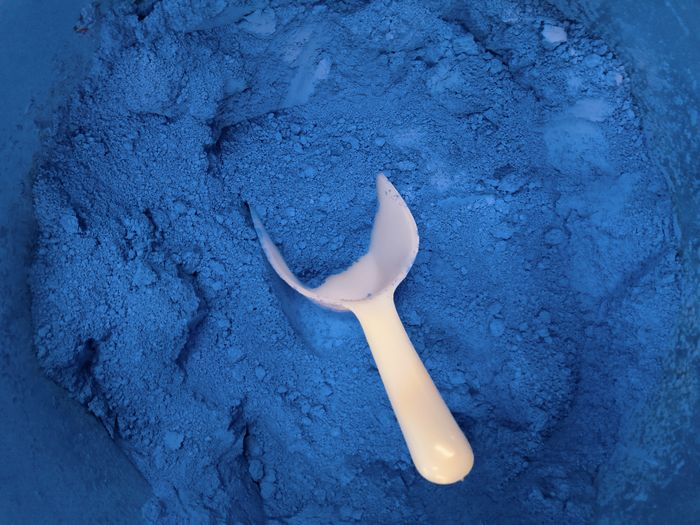 Blue Color Pigment Powder Pigment Dry Natural Spoon Vibrant Color Ultramarine Synthetic Art And Craft Industry Softness Fine Ingredient Intense Blue High Angle View Close-up