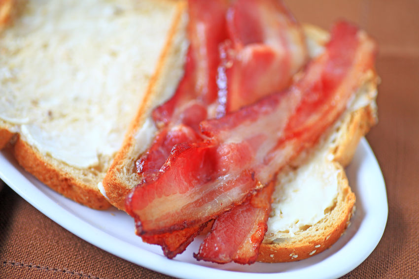 Bacon on buttered bread Bacon Bread Breakfast Close-up Day Freshness Home Cooking Homemade Food Indoors  Lunch Meal Natural Lighting No People Overhead Pork Ready-to-eat Salty Food Serving Size Slices Smoked Snack Table Textures White Platter