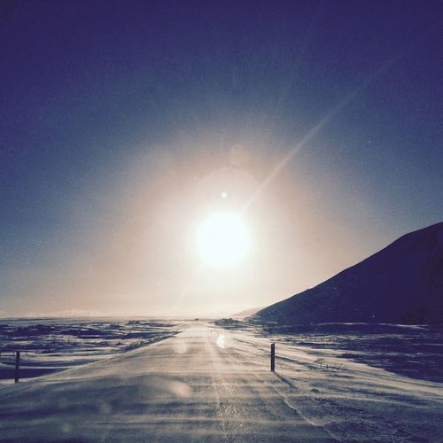 Snow blowing over icy roads Iceland