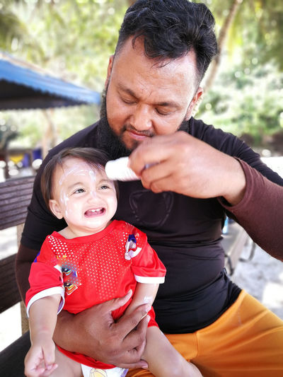 Pulau Redang, Terengganu, Malaysia. Family With One Child Family Child Real People Bonding Parent Emotion Childhood Togetherness Baby Men Young Father Males  Positive Emotion Mid Adult Love Daughter Innocence Cute Son Care