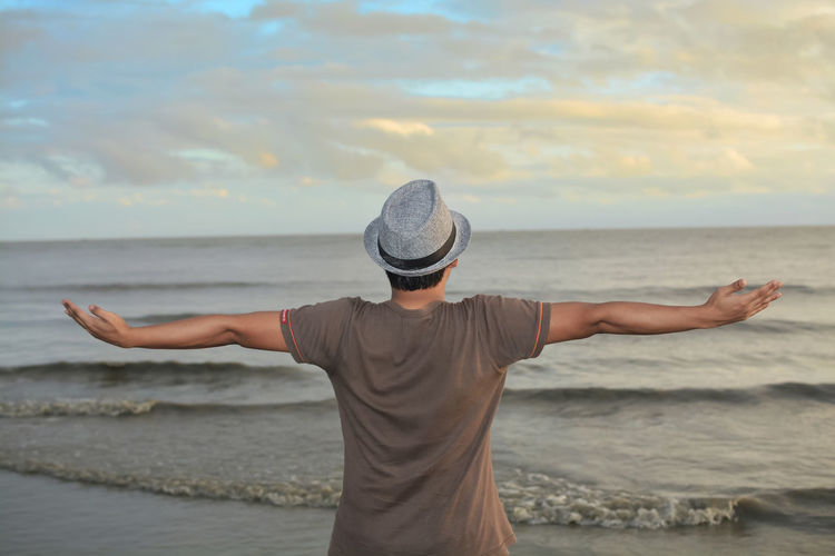 Vastness of the sea Cloud Bay Of Bengal Sea Sea And Sky Seascape Human Stretching Cap Ocean Wave Nature Nature_collection Nature Photography Afternoon Sunset Sunlight Sea Muscular Build Beach Water Men Sunset Healthy Lifestyle Horizon Standing Bicep Human Back Back Shore Shoulder
