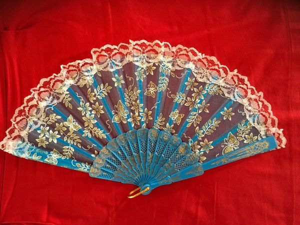 against the heat Cool Down Folding Fan Red Indoors  Pattern Still Life No People High Angle View Close-up Studio Shot Table Personal Accessory Red Background Decoration Blue Textile
