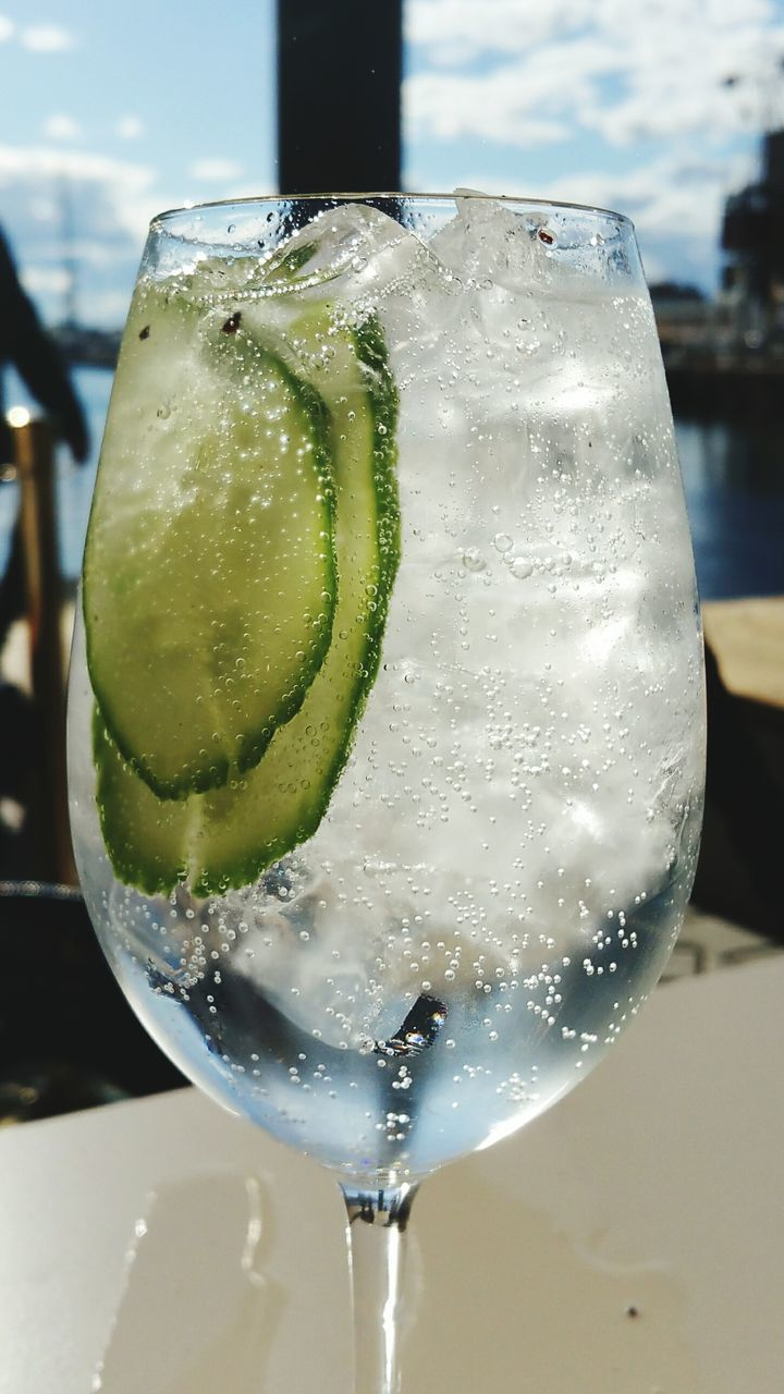 drink, refreshment, food and drink, drinking glass, close-up, table, alcohol, cold temperature, no people, freshness, focus on foreground, gin, tonic water, cocktail, slice, ice cube, indoors, day