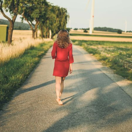Adult Adults Only Barefeet Barefoot Day Footpath Full Length Grass Green Color Nature On The Move One Person One Woman Only One Young Woman Only Only Women Outdoors People Rear View Red Road The Way Forward Tree Walking Women Young Adult Long Goodbye