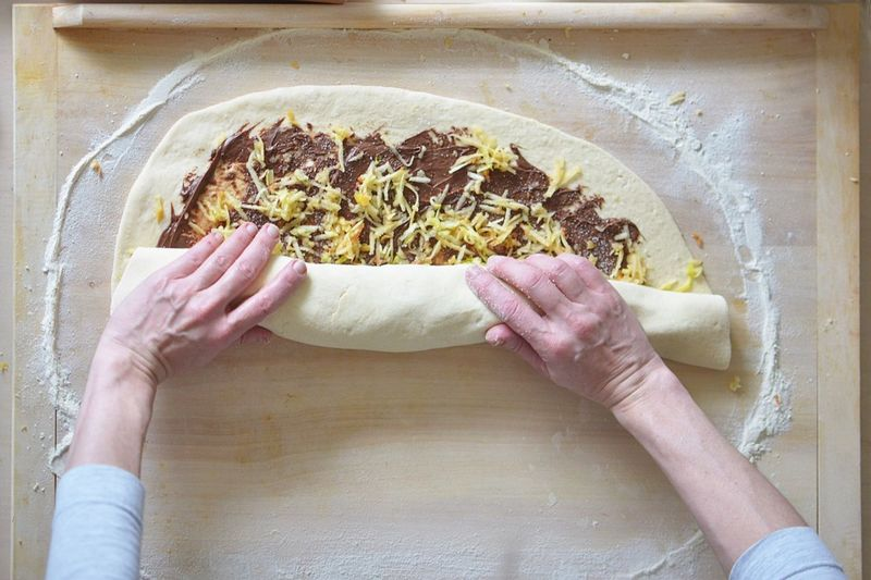 baking yeast cake with cocoa filling Apple Ingredients Baker Baking Butterfly Cocoa Powder Dough Egg Flour Food Food And Drink Freshness Handmade Home Work Indoors  Kitchen Milk Preparation  Recipes Traditional Food Woman Hands Wood Table Yeast Dough