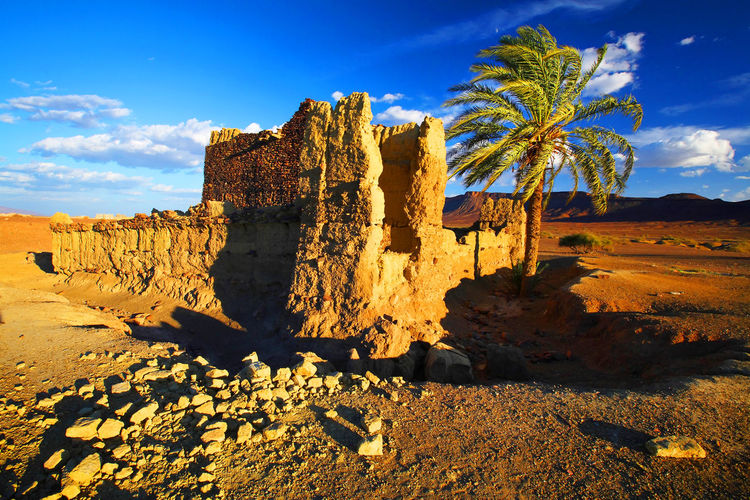 Old Ruin In Desert Against Cloudy Sky