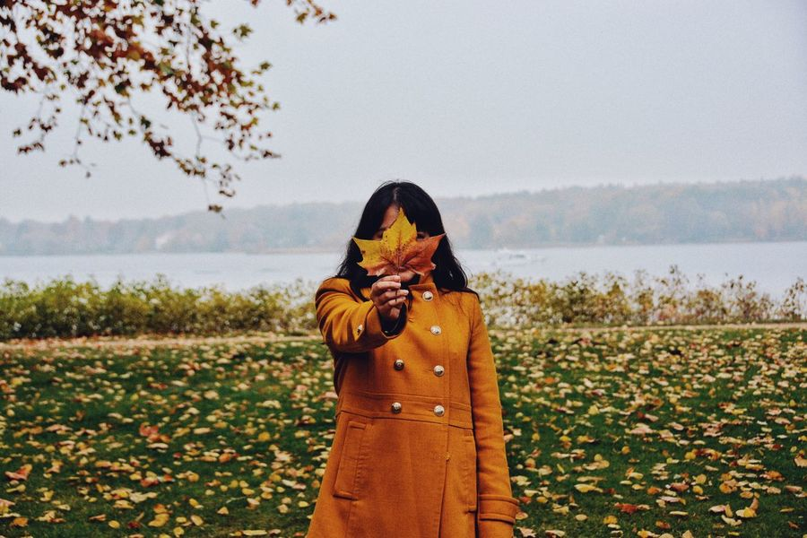 Orange is here. Change Fallen Leaves Fall Color Textures and Surfaces Texture Cold Season  Autumn Orange One Person Real People Lifestyles Beauty In Nature Waist Up Nature Leisure Activity Plant Scenics - Nature Women Standing