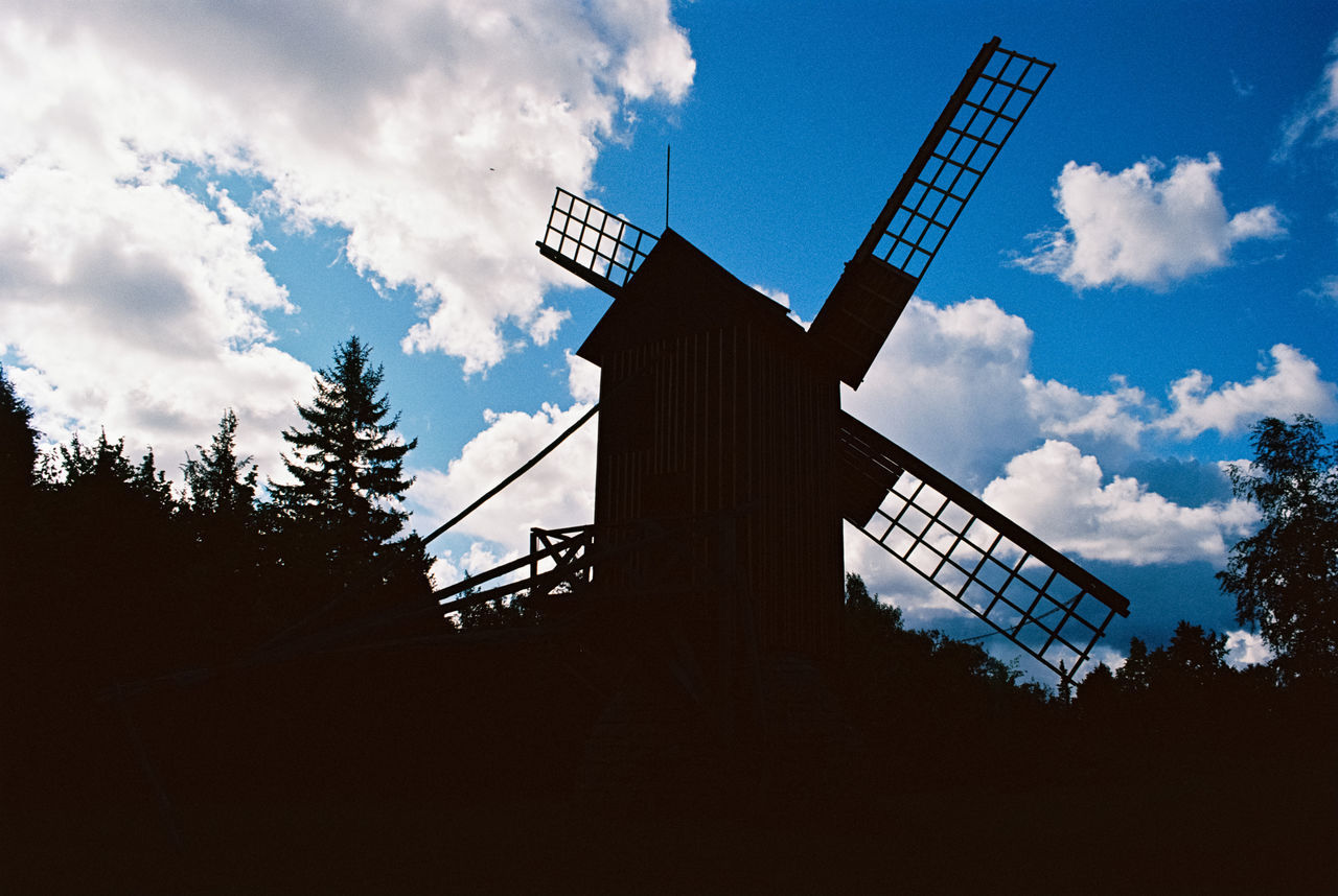 sky, cloud - sky, low angle view, renewable energy, alternative energy, nature, environmental conservation, fuel and power generation, wind power, wind turbine, turbine, built structure, environment, architecture, traditional windmill, silhouette, tree, no people, outdoors, day