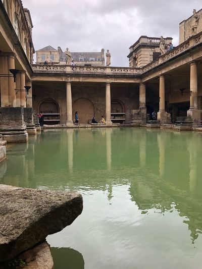 EyeEm Selects Roman Bath Bath History Historical Building Architecture Built Structure Building Exterior Water Sky Travel Destinations Reflection Travel Cloud - Sky Outdoors Day Bridge - Man Made Structure City No People Green Water Postcode Postcards