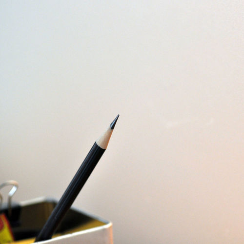 Close-up of pencil against wall