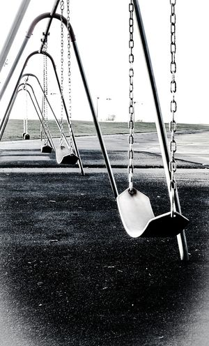 Loneliness... A second time. Showcase: December My Best Photo 2015 Lonely Blackandwhite Swing B&w Perspective Loneliness Swings Playground Cold Alone Imhere