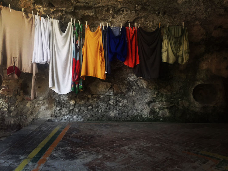 Architecture Built Structure Cloth Clothesline Clothing Coathanger Day Drying Hanging Indoors  Laundry Multi Colored No People Textile Window