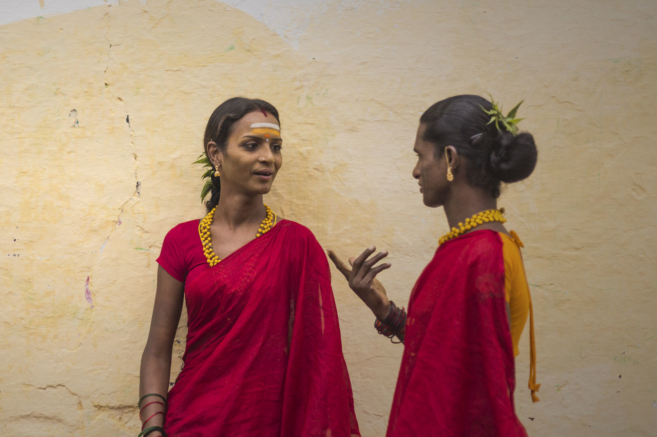 two people, young women, young adult, day, standing, togetherness, real people, red, outdoors, girls, sari, friendship, people