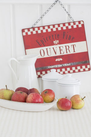 Still Life with apples, white enamel containers and decorative sign Sign Apple - Fruit Clean Eating Country Life Decorative Enamel Food Food And Drink French Fresh Freshness Fruit Healthy Eating No People Pitcher Red Still Life Sweet Food Table Text Vintage White