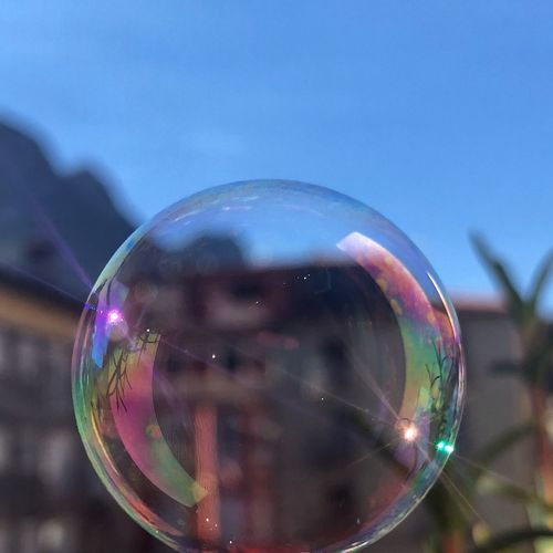 Bubble Fragility Vulnerability  Sphere Reflection Nature Soap Sud Transparent Close-up Focus On Foreground Sky No People Shiny Glass - Material Geometric Shape Outdoors Mid-air Day Shape Single Object