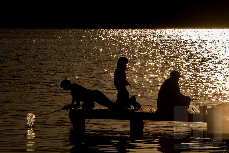 Silhouette Sunset Water Tranquility Nature People Children Playing Fishing Germany Mecklenburger Seenplatte