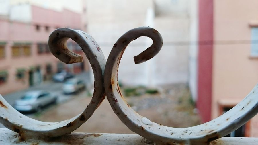 Close Up Of Rusty, Curved Railing