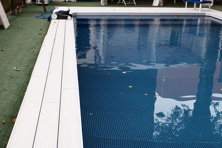 Reflection of people on swimming pool
