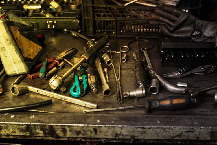 Mechanic tools on dirty work table Abundance Choice Close-up Complexity Equipment Group Of Objects Hand Tool High Angle View Indoors  Large Group Of Objects Man Made Object Metal No People Old Screwdriver Spanner Still Life Table Tool Variation Work Tool Workshop