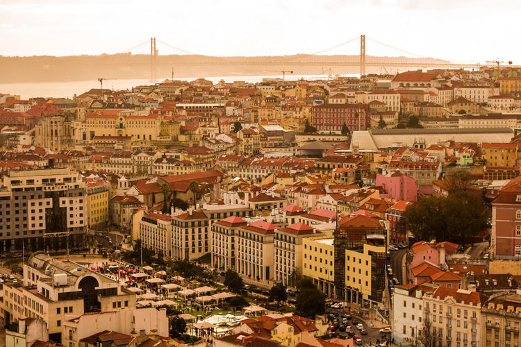 Architecture Bridge Building Exterior Built Structure Business Finance And Industry City Cityscape Day High Angle View Lisbon No People Outdoors Residential Building Sky Sunset Sunset_collection Travel Travel Destinations Urban Skyline View Traveling Home For The Holidays