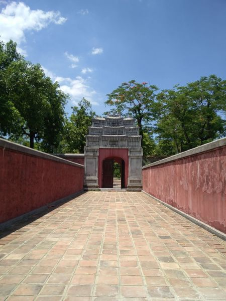IN is the only way OUT. A maze of a location this. Imperial City Citadel, Hue, Vietnam. Asian Culture Tourism #cotadel #capital #Vietnam #HueCity #Fort #palace #pathway #walls #Pink  #doorway #entrance #arch #ancient #heritage #culture #preserved #walking #converge #way Out #WayOut!!! Politics And Government City King - Royal Person Red Cityscape History Sky Architecture