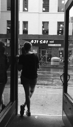 Waiting for the rain to stop. Architecture Building Exterior City Lifestyles Person City Life The Magic Mission