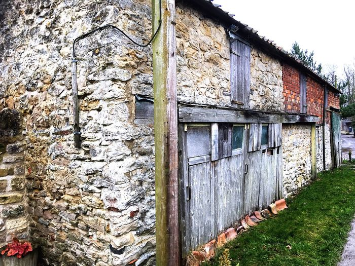 Rickety barn door Hand Chiselled Textured Surface Built Structure Architecture Building Exterior No People Day Building Wall Wall - Building Feature Old Outdoors The Architect - 2018 EyeEm Awards